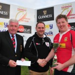 08 Larne Captain receives Quigg Golden Bowl Trophy from the sponsor